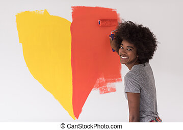 black woman painting wall - portrait of a young beautiful...