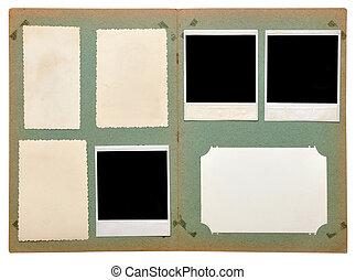 vintage photo album with empty photos on white