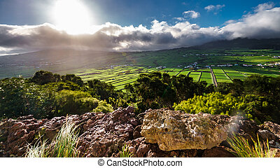 High contrast backlit of farm fields in the Terceira island,...