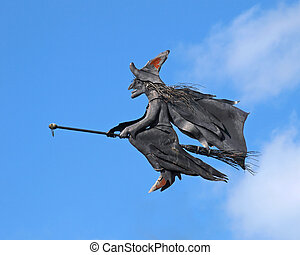 Witch on a broom - witch flying on a broom