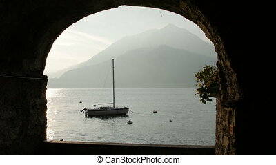 Boat on Lake Como at the sunset. - Boat on Lake Como at the...
