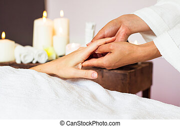 Woman receiving a hand massage at the health spa.