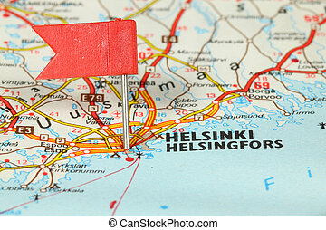 Helsinki - famous city in Finland Red flag pin on an old map...