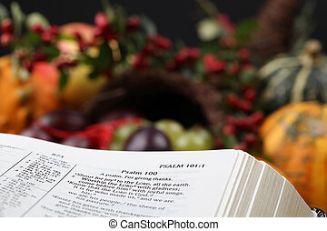 Thanksgiving Bible and cornucopia - Bible open to Psalm 100...
