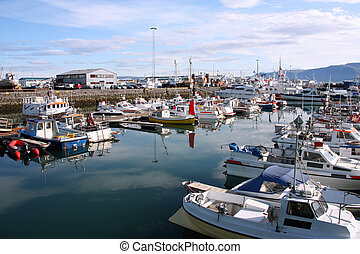 Reykjavik harbor. Motorboats, yachts and small fishing...