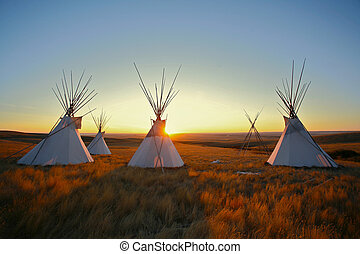 Tipis at sunrise on the prairie - Group of North American...