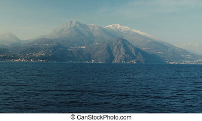Panoramic view of Lake Como, the Alps above. - Panoramic...