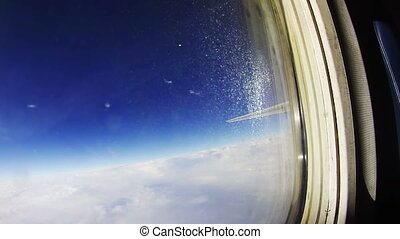View from an Airplane Window above the Clouds - View from an...