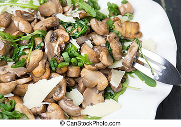 Mushrooms with vegetables on a plate close up