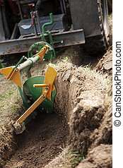 Tractor ploughing a dry soil