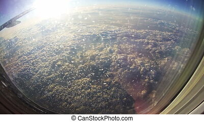 Clouds Seen Through the Window of Jet Airplane on Sun...