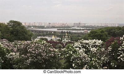 View through the blooming lilacs on Kiev Pechersk Lavra