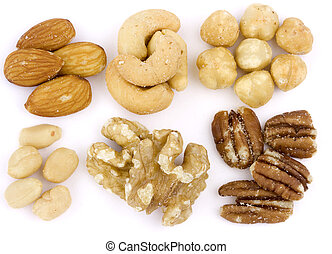 Roasted and salted mixed nuts on wh - An assortment of...