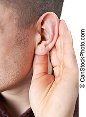 Close Up Of Young Man Suffering With Hearing Difficulties