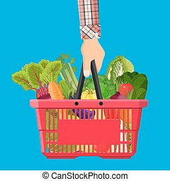 Red plastic shopping basket full of different healthy food....