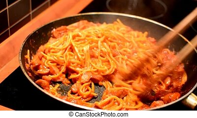 Cooking of a spaghetti - Cooking and stirring the spaghetti...