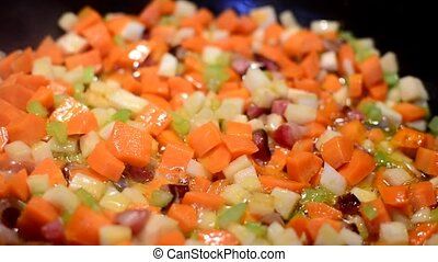 Frying of a vegetable - Frying of a sliced vegetable,...