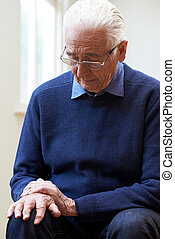 Senior Man Suffering With Parkinsons Diesease