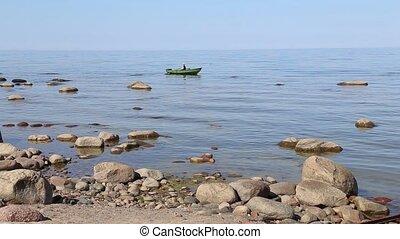 Boy sails the Boat with Oars Baltic Sea Roja sea coast