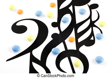 Music notation elements and pills on white background