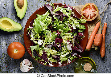 ingredients to prepare a salad - high-angle shot of a rustic...