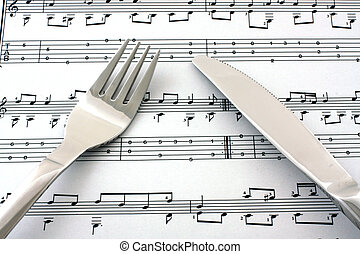 Sheet of notes with fork and knife