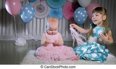 Two little girls play