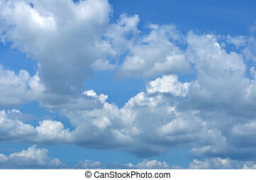Blue sky with fluffy cloud for background.