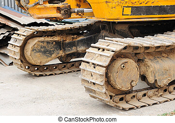 Part of caterpillar tractor on construction area