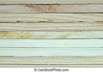 Close up stack of wooden plank.