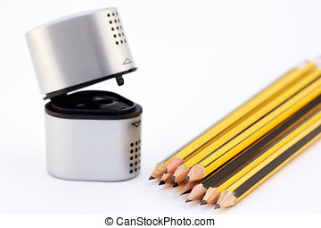 sharpener and pencils on a white background