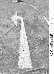Turn left white traffic sign on road.