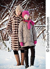 Smiling Daughter and Mother in Winter Park