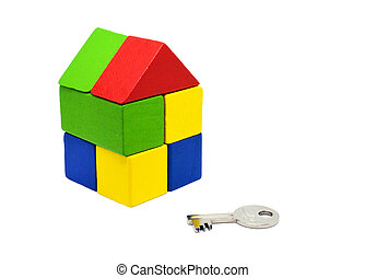 close up of home model and key. Mortgage concept.