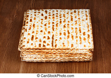 matzo on wooden table - matzo flatbread for Jewish high...