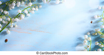 art Lily valley spring flower on blue background