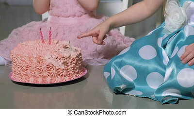 kids eating birthday cake - Cute little girls dressed like...