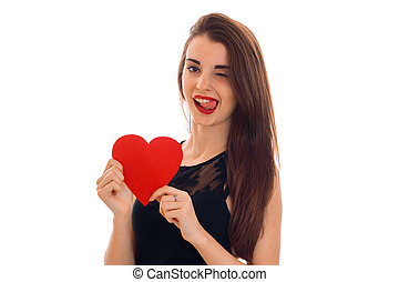 beautiful girl with red lipstick on lips holding a postcard sweetheart and winks
