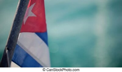 Cuba flag on a boat at sunny day