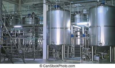 Chemical Plant. Shiny stainless steel storages, pipeline at a modern industrial factory.