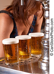 Draft pints ready to be served by the waitress