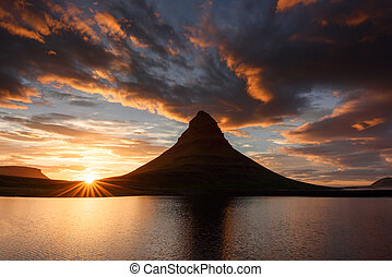 Kirkjufell - Colorful sunset on Snaefellsnes peninsula near...