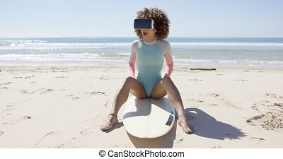 Female wearing virtual reality glasses on beach - Female...