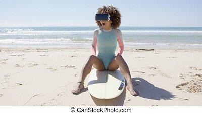 Female wearing virtual reality glasses on beach - Female...
