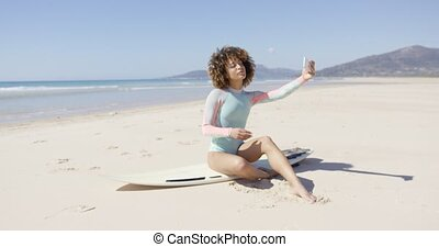 Female taking selfie on sea background - Female posing...