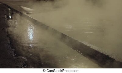 Steaming hot water at night city road, woman try to cross it, but walk away