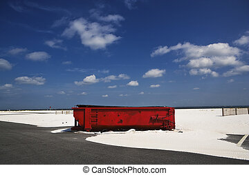 Red Dumpster & Sands, Gulf Coast - A large red dumpster sits...
