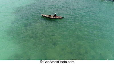 Sea and fisherman on the boat - Aerial view of sea and...