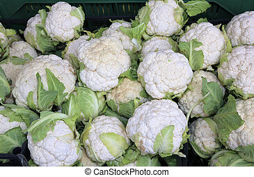 many cauliflowers for sale in greengrocers stall - white...