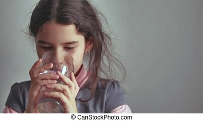 girl teen drinks water from a glass cup the indoor - girl...